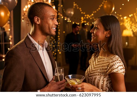 Couple Chat As They Enjoy Cocktail Party Together #623097995