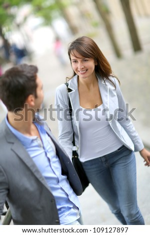 Couple climbing stairs in town