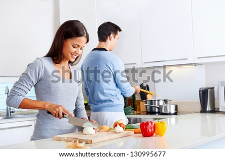 couple cooking healthy food in kitchen lifestyle meal preparation