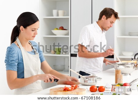 Couple cooking together their lunch in the kitchen
