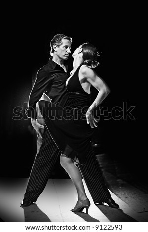 Couple dancing hot latin dance at night