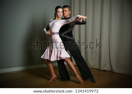 couple dancing Latin dances. man and woman show the movement of the dance Rumba.  #1341419972