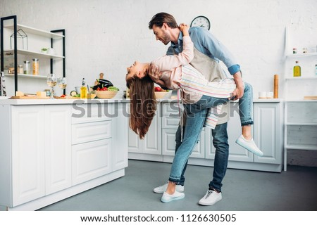couple dancing tango together in kitchen #1126630505