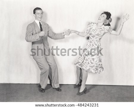 Couple dancing the jitterbug #484243231