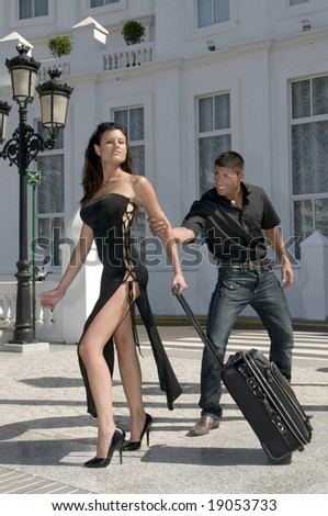 couple discussion in the street with woman leaving home - stock photo