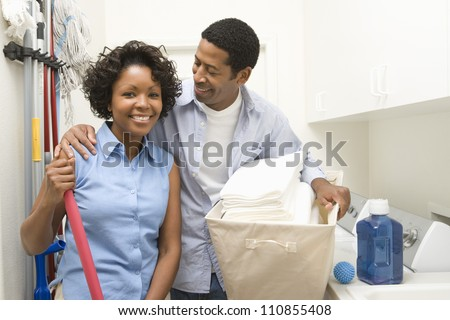 Couple Doing Household Chores