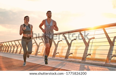 Couple doing sport together on the street. Morning run Foto stock ©