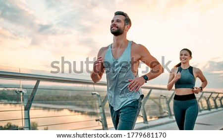 Couple doing sport together on the street. Morning run stock photo