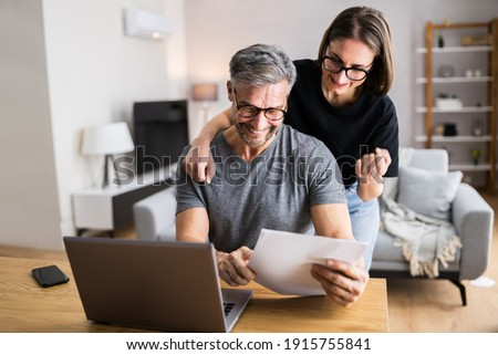 Couple Doing Taxes And Family Budget On Computer Foto stock ©