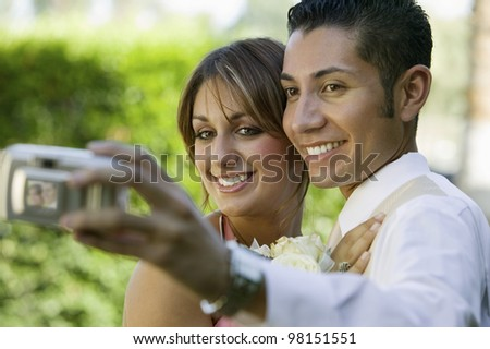 Couple Dressed for Dance Taking Self Portrait