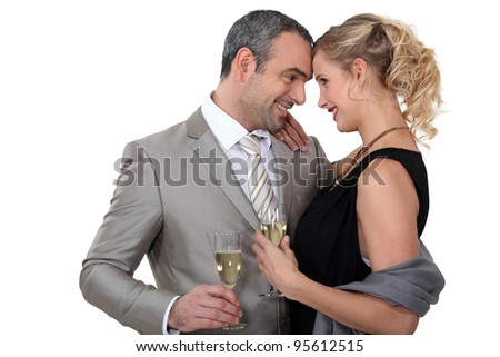 Couple drinking champagne in studio