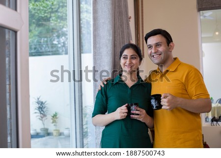 Couple drinking coffee and admiring view from balcony  Stock photo ©