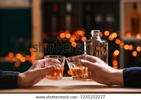 Couple drinking whiskey in bar #1235232277