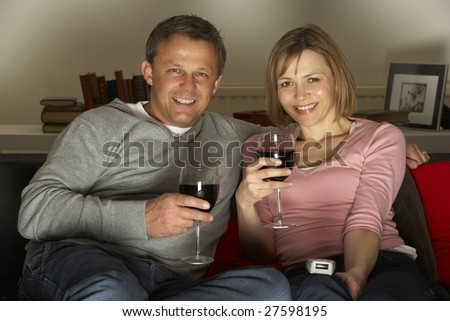 Couple Drinking Wine And Watching Television