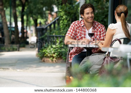 Couple Drinking Wine At Sidewalk Cafe