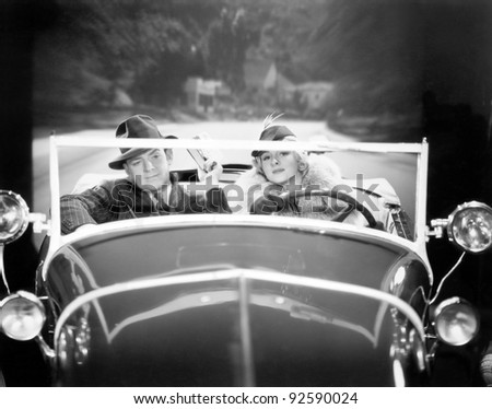Couple driving a car