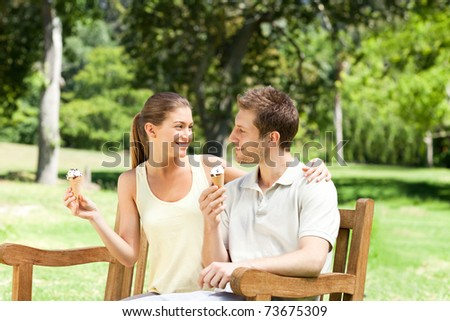 Couple eating an ice cream in the park