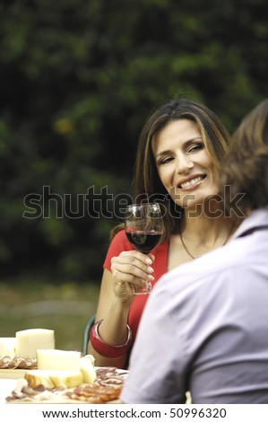 couple eating and drinking outdoor