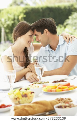 Couple Eating meal Outisde