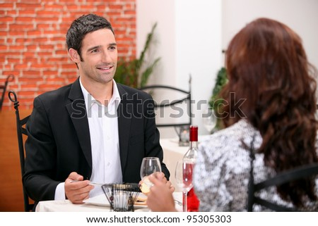 Couple eating out in a restaurant