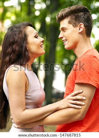 Couple embracing at park. Outdoor.