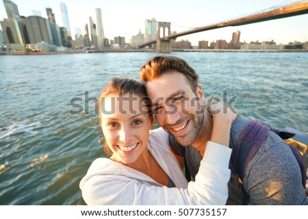 Couple embracing each other, Brooklyn bridge in background