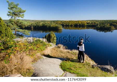Couple enjoy of beautiful autumn landscape