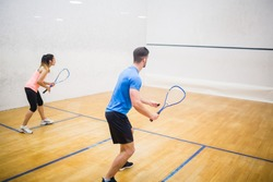 Couple enjoying a game of squash in the squash court