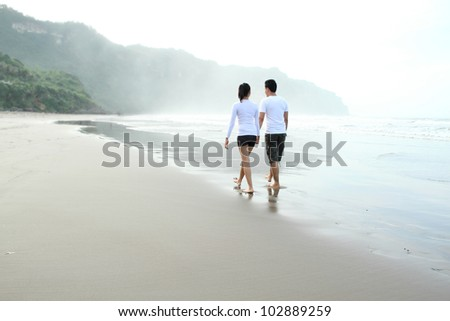 Couple enjoying a summer vacation on the beach