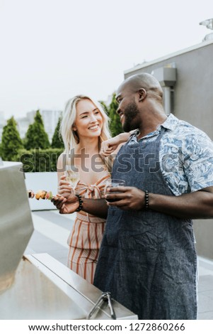 Couple enjoying barbeque skewers and a glass of wine #1272860266