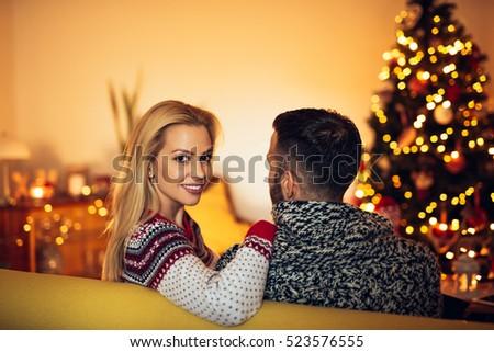Couple enjoying christmas mood together at home.