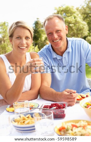 Couple Enjoying Meal In Garden Stock photo ©