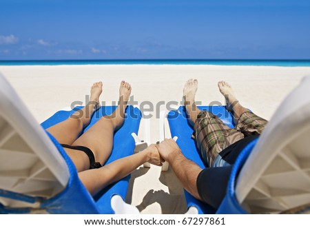 Couple enjoying Peace, love and tranquility on a secluded beach