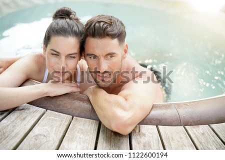 Couple enjoying relaxing time in hot tub water