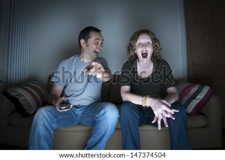 couple enjoying watching television together