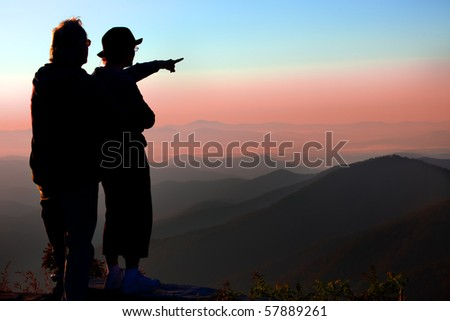 Couple enjoys sunrise over Blue Ridge mountains in NC