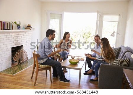 Couple Entertaining Friends At Home