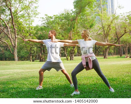 Couple exercising in the park. #1405142000
