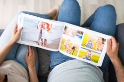 Couple Family Looking Photo Album Or Photobook