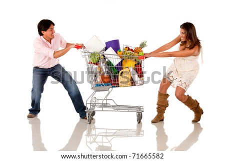 stock photo : Couple fighting over a shopping cart - isolated over white