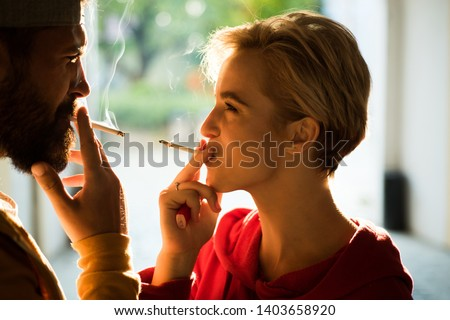 Couple find place for smoking cigarette in tranquility. Enjoying every breath of smoke. Smoking habit. Tobacco industry. Woman smoking cigarette urban background. Pause for relaxing smoking.