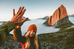 Couple friends giving five hands traveling outdoor hiking in Norway mountains adventure lifestyle positive emotions concept family together on journey vacations