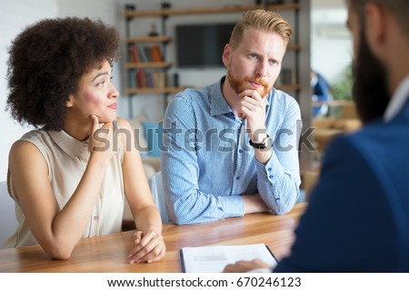 Couple getting advice about buying a house.