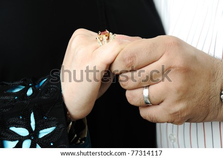 Couple getting married, hands and rings on fingers