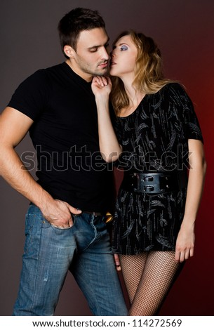 couple - girl and guy near the wall - stock photo