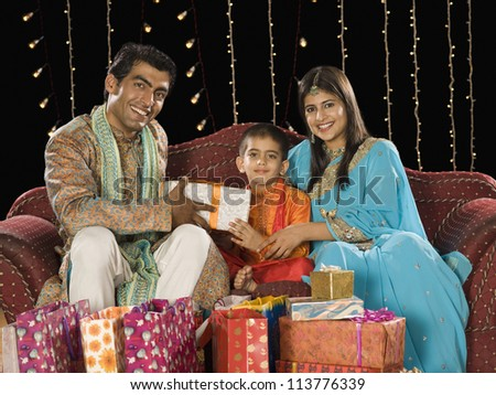 Couple giving gifts to their son on Diwali festival
