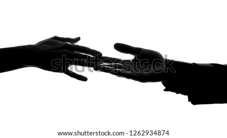 Couple hands separating, relations conflict, losing love partner, breakup symbol
