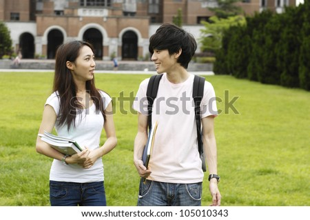 Couple happy college student at a campus