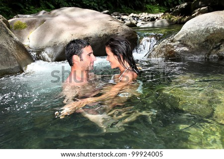 Couple having a bath in fresh river water