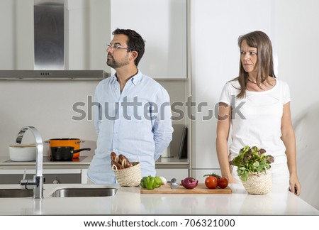 couple having a disagreement  in a kitchen